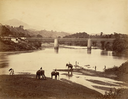 The Ralajastulla Bridge [Katugastota Bridge] over the great river Wahawaliganja [Mahaweli Ganga], rebuilt by the British on the old original piles of stone supports [Ceylon]